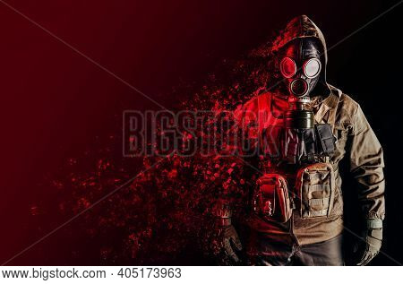 Photo Of A Stalker Soldier In Soviet Gas Mask, Jacket And Armored Vest Standing And Dissolving With