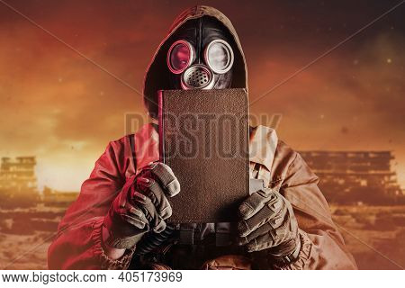 Photo Of Stalker Soldier In Soviet Gas Mask Holding Closed Old Book On Destructed Ruined Wasteland B