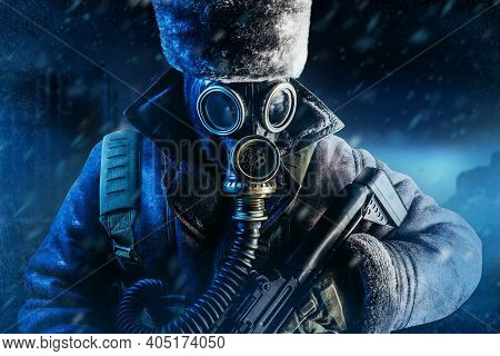 Photo Of Winter Stalker Soldier In Fur Coat, Hat Standing With Pouch Vest, Gas Soviet Mask And Rifle