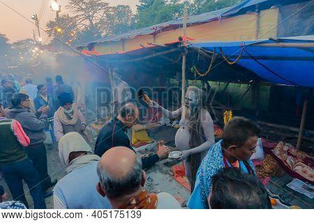 Kolkata, West Bengal, India - 12th January 2020 : Hindu Sadhu Blessing Devotee At Gangasagar Transit