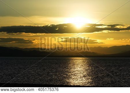 Cloudy sunset over Uureg Nuur Lake, saline lake in western Mongolia