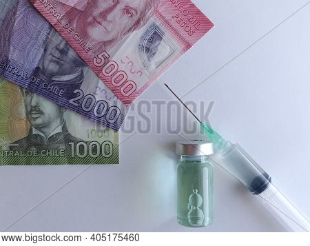 Chilean Banknotes, Syringe And Bottle With Medicine