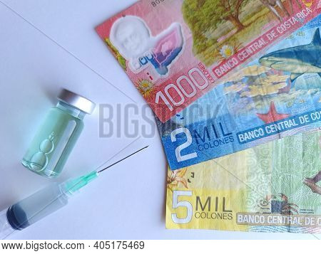 Costa Rica Banknotes, Syringe And Bottle With Medicine