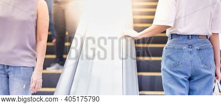 Female Hand Touching Escalator Handrail While Using Escalator In Shopping Mall Or Public Area For Mo