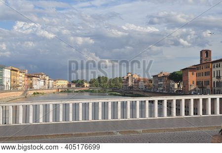 View From Bridge Over Arno River In Pisa, Italy. Pastel Houses.