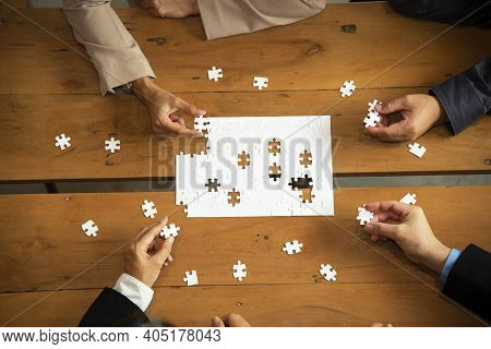 Hands Of Business People Holding Jigsaw, Thinking About The Successful Good Fit For Concept Of Corpo