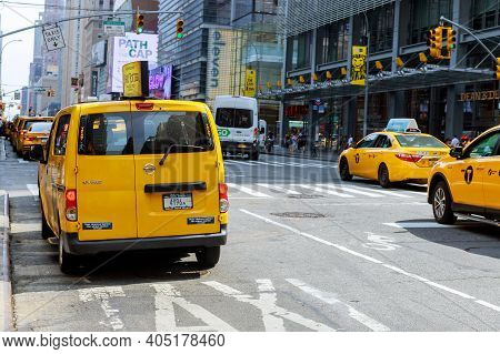 August 28 2020 New York Ny Usa: Group Of Yellow Taxi Cabs Rush Tourists Manhattan In New York City,