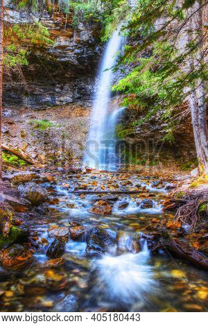Long Exposure Of Troll Falls, A Waterfall Located In The Wild And Secluded Kananaskis Country Of Alb