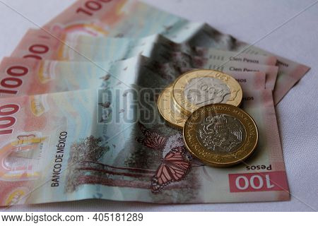 Approach To Mexican Banknotes Of 100 Pesos And Coins