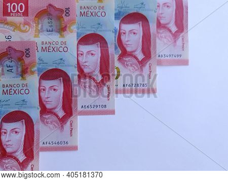 Row Of Mexican 100 Pesos Bills On White Background