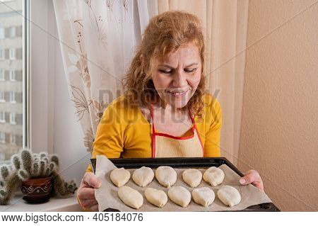 A Woman Admires Russian Pies Prepared For Baking. Homemade Baking.