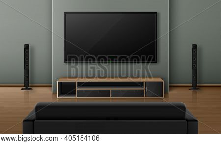 Living Room Interior With Sofa Back View And Tv With Dynamics. Home Theater System With Television O