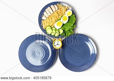 Two Empty Plates And One Plate Of Food, Concept Of Intermittent Fasting.