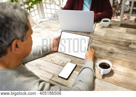 Senior african american woman using digital tablet at home. retirement lifestyle in self isolation during coronavirus covid 19 pandemic.
