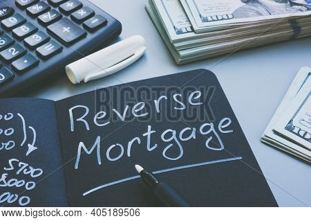 Reverse Mortgage With Calculations And Money On The Surface.