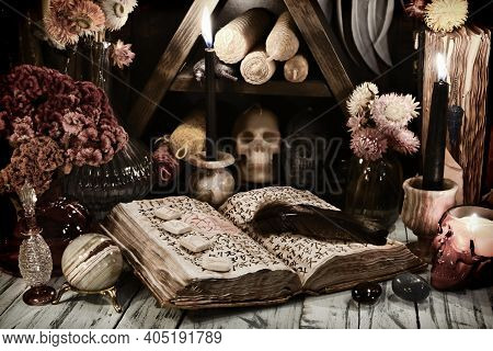Still Life With Old Grimoire Book Of Magic Spells, Runes And Evil Candles On Witch Table. Esoteric,
