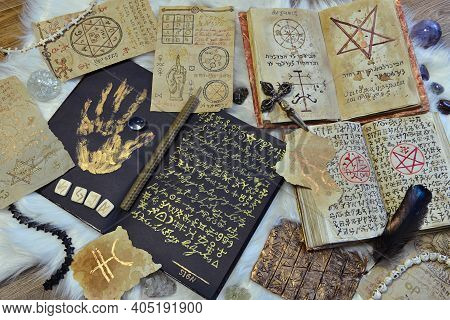 Still Life With Old Manuscripts, Parchments And Papers With Magic Symbols, Spells And Pentagram On W