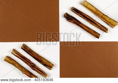 Geometric Composition With Useful Dried Treats For Pets. Dried Bovine Penis, Bully Sticks, Beef Pizz
