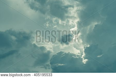 Gray Sky And Fluffy Clouds With Sunlight. Cloudy Sky. Hope In Darkness Day. Overcast Sky. Background