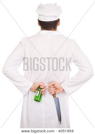 Cook With Knife And Green Bottle