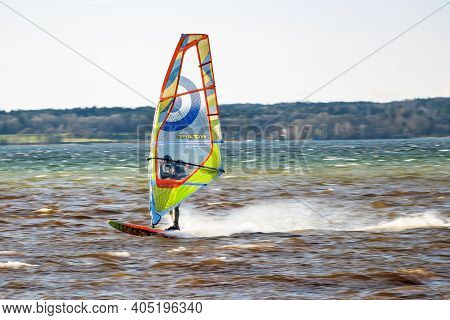 Starnberg, Germany - Sep 19, 2019: Surfer At Lake Starnbeger In Upper Bavaria, Germany