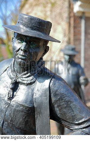 Edam, Netherlands - September 17, 2020: Close-up On The Statues Of Cheese Carriers (sculptor Jans Va