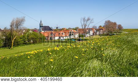 Panorama Village Oudeschild With Martinus Church, Windmill And Trraditional Gable Houses On The Wadd