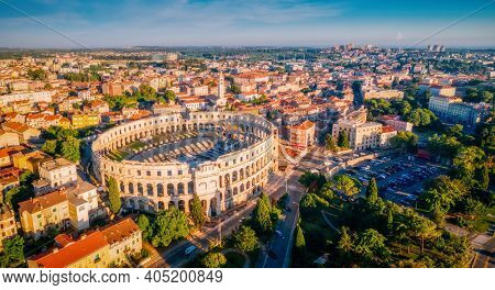 Majestic view at famous european city of Pula and arena of roman time. Location place of Istria county, Croatia, Europe. Wonders of the world. UNESCO world heritage site. Discover the beauty of earth.