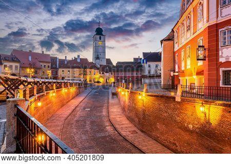 Sibiu, Romania - Lesser Square And Council Tower At Twilight. Transylvania Saxon City.