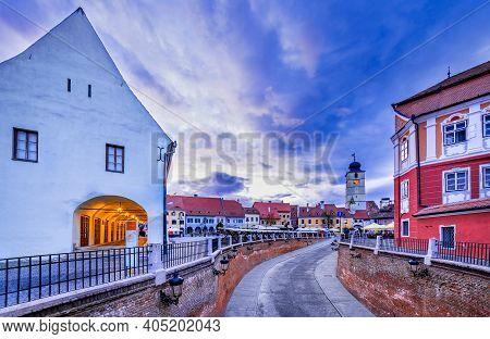 Sibiu, Romania - Lesser Square And Council Tower Morning Cloudy Day, Transylvania Saxon City.