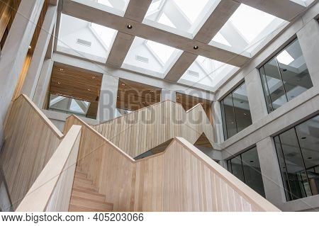 Wageningen, Netherlands, - January 26, 2016: Wooden Staircase In Office Building Plus Ultra On The C