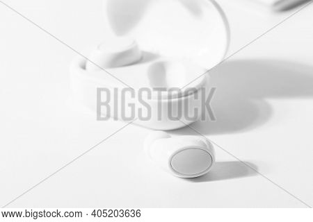 White wireless earbuds with case