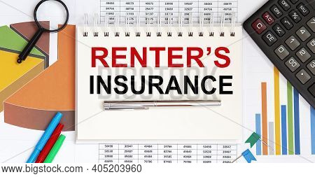 Notepad With Text Renter's Insurance, Paper Clips, Pen,on Financial Diagrams. Business