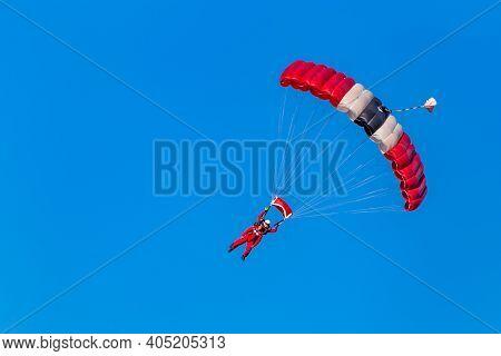 Ede, Netherlands, September 19, 2019: British Red Beret Paratroopers Duo Landing Memorial Operation