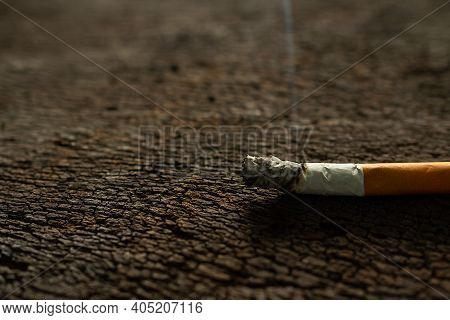Addictive Substance, Narcotic, Habit-forming Substance Concept. Cigarettes On Old Wood.