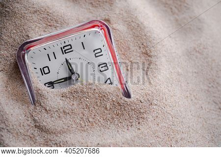 Clock On Sand Beach. Conceptual For Time Period, Waiting, Patience, Continuous Development.