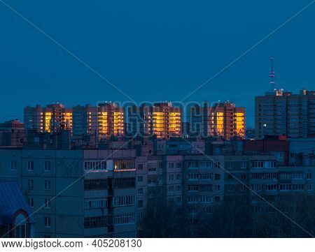 Fantastic Sunrise With Gold Glow In Windows Of Highrise Buildings In Cheboksary City, Russia