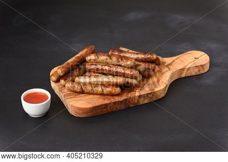 Fried Sausages With Hot Chilisous Sauce, Close Up.