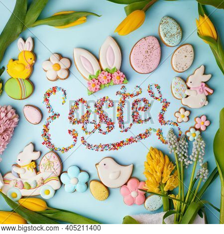 Food Lettering Easter Colorful Easter Cookies And Flowers Tulip On Blue Background, Assortment Sweet