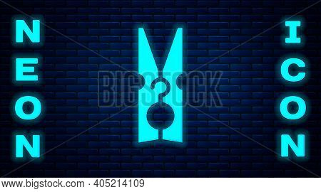 Glowing Neon Old Wood Clothes Pin Icon Isolated On Brick Wall Background. Clothes Peg. Vector