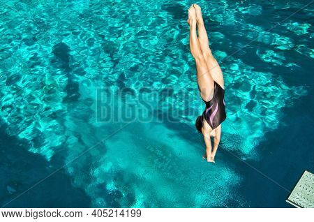 Portrait of woman diving in pool