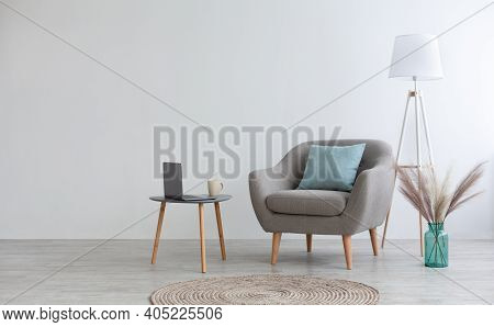 Cozy Boho Design For Remote Work And Leisure At Home. Gray Vintage Armchair With Pillow, Table With