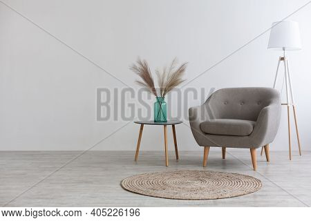 Mockup Modern Interior, Gray Furniture In Living Room. Vintage Armchair, Table With Vase With Dry Pl