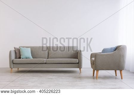 Cabinet Or Gray Living Room At Home And Minimalism In Scandinavian Design. Sofa With Pillows And Vin
