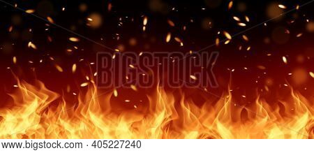 Fiery Flame With Sparks And Fire Texture On A Black Background. Firefighter Explosion For Background