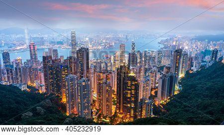 Hong Kong, China city skyline from Victoria Peak at dusk.