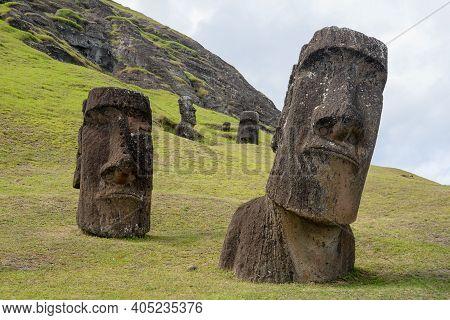 Moais At Rano Raraku Volcano's Slopes At Easter Island, Valparaiso, Chile.
