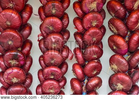 Dangling Red Onions Bunches Of Heads, Harvesting Of Vegetables, Autumn Harvest. Bundles Of Purple On