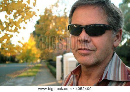 Middle Aged Man In Neighborhood Scene
