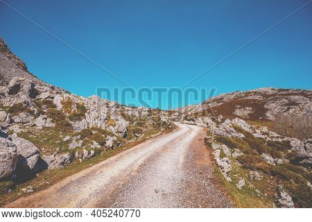 Car Driving On A Mountain Winding Road. The Road From Glacial Lake Enol To Lake Ercina. National Par